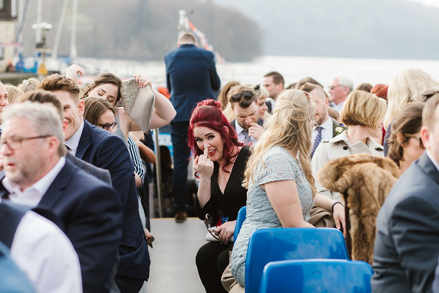 Guest gives photographer 'the finger' on board cruiser on Lake Windermere at Belsfield Hotel wedding