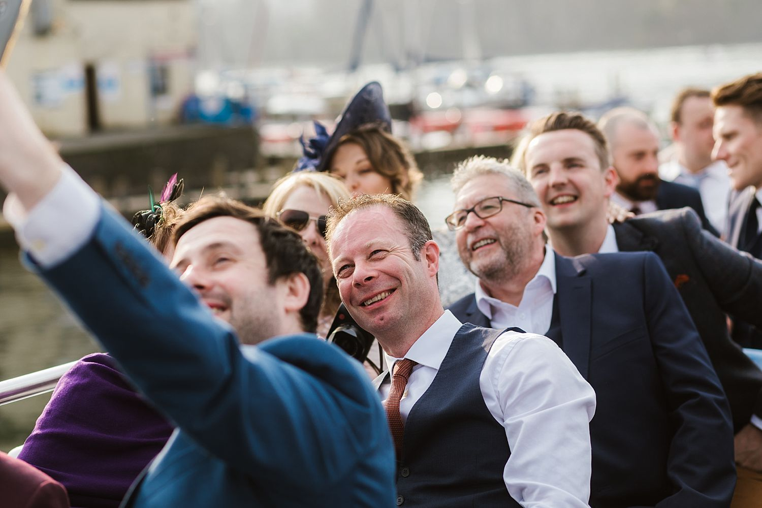 Wedding guests take 'selfie' on board Windermere cruiser at reception for Belsfield Hotel wedding