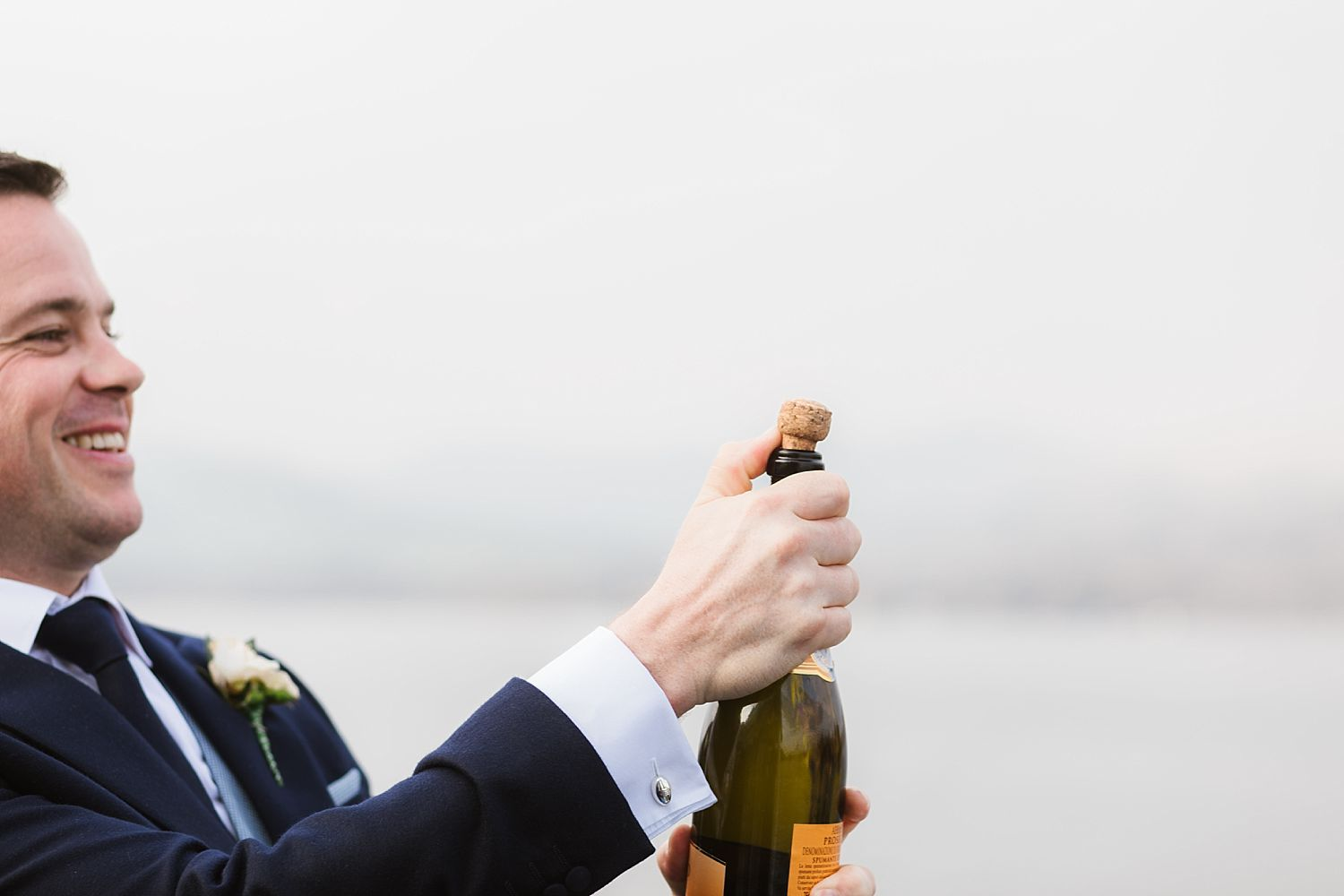 Guest pops champagne cork at Belsfield Hotel wedding