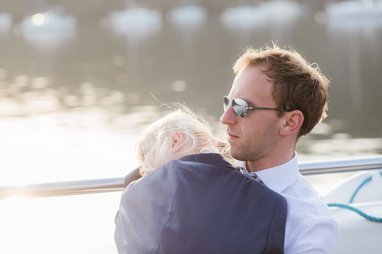 Guest cuddles his young daughter on board Lake Windermere cruiser at Laura Ashley , Belsfield Hotel wedding