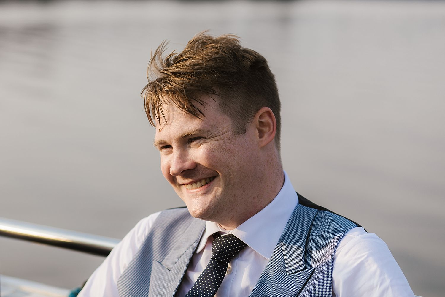 Smiling groom on board Lake Windermer cruiser