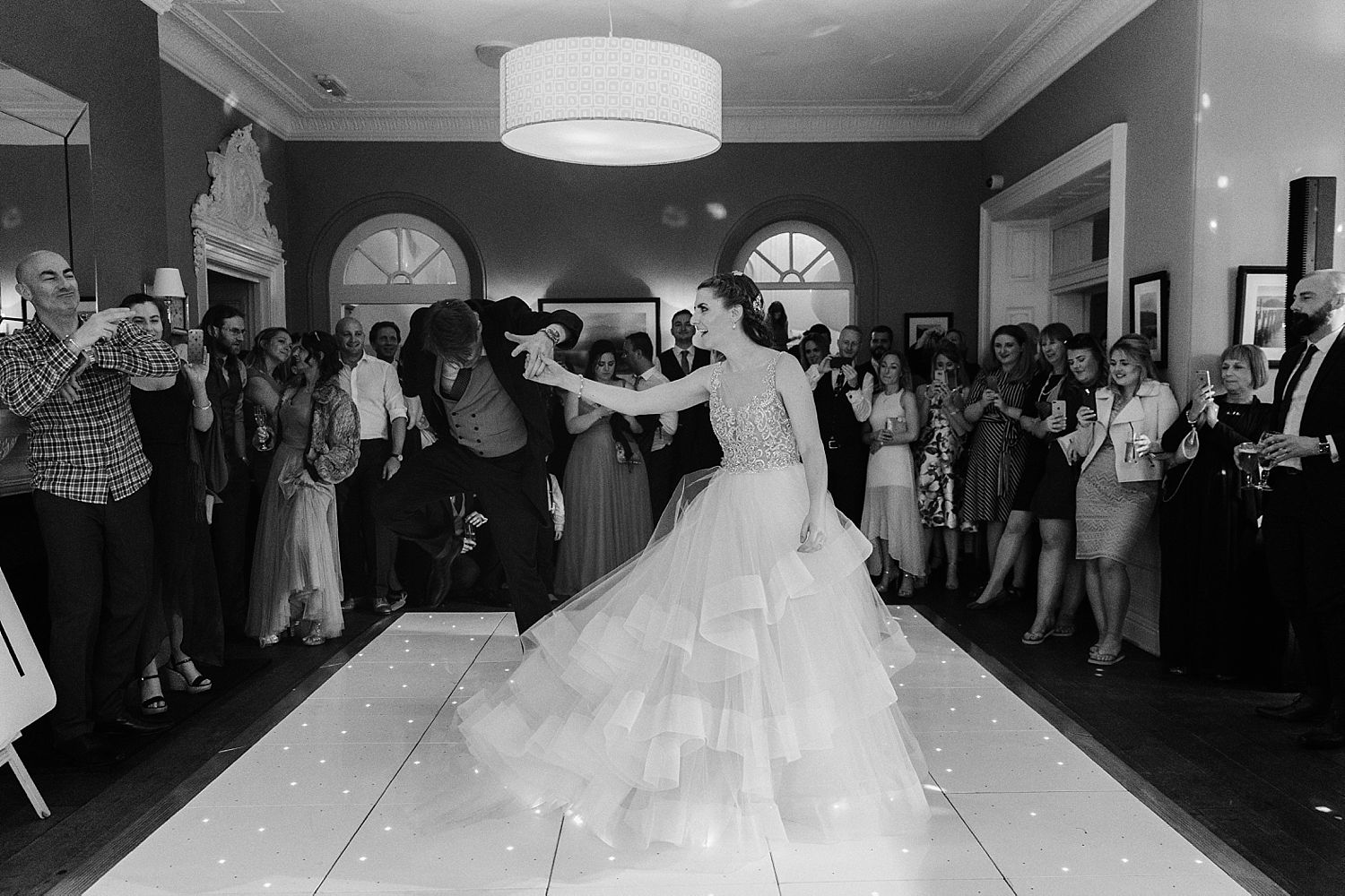 groom jumping during furst dance with bride at Laura Ashley, Belsfield Hotel wedding