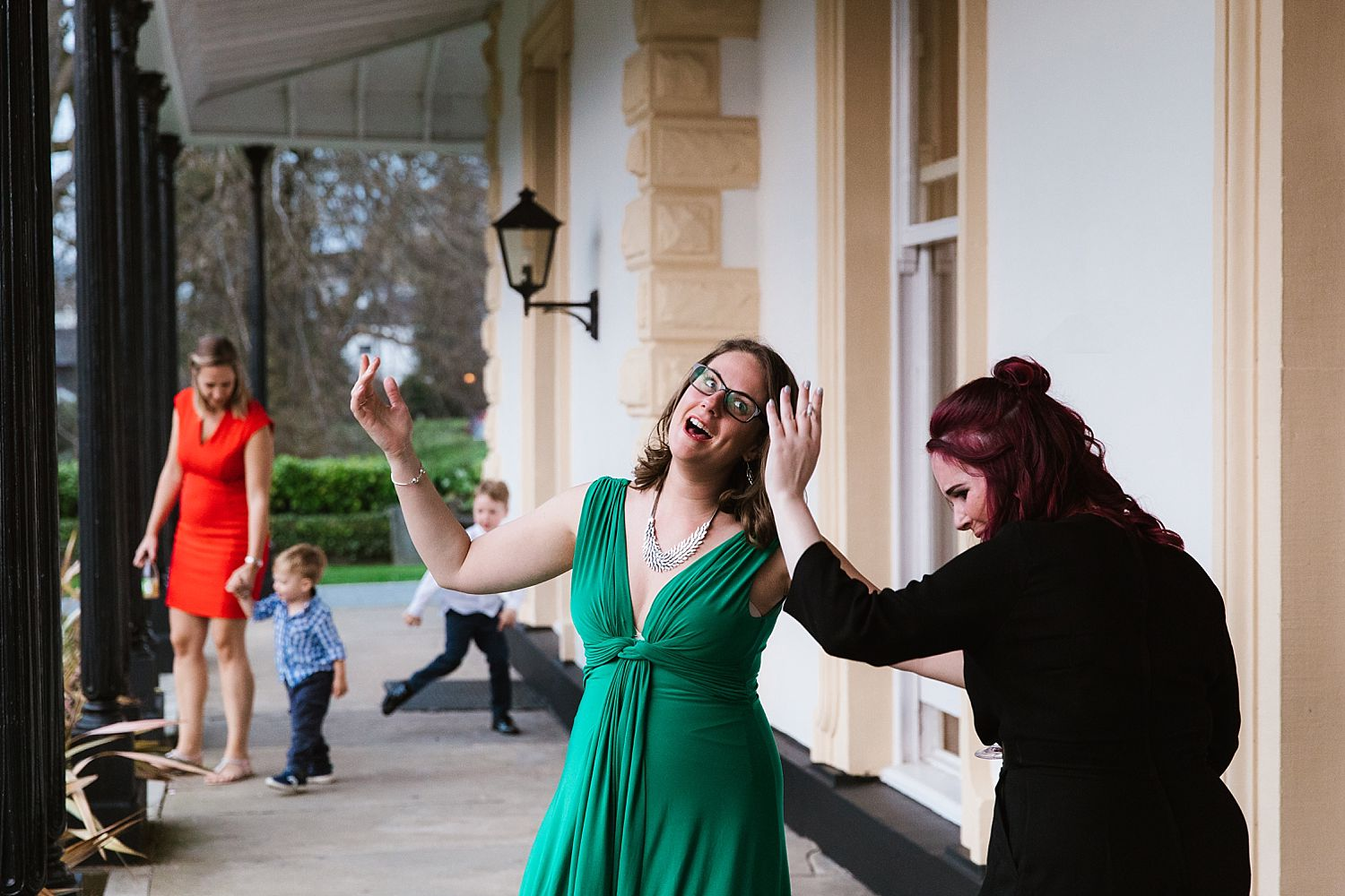 Two guests dancing outside a wedding reception at the Laura Ashley Belsfield Hotel