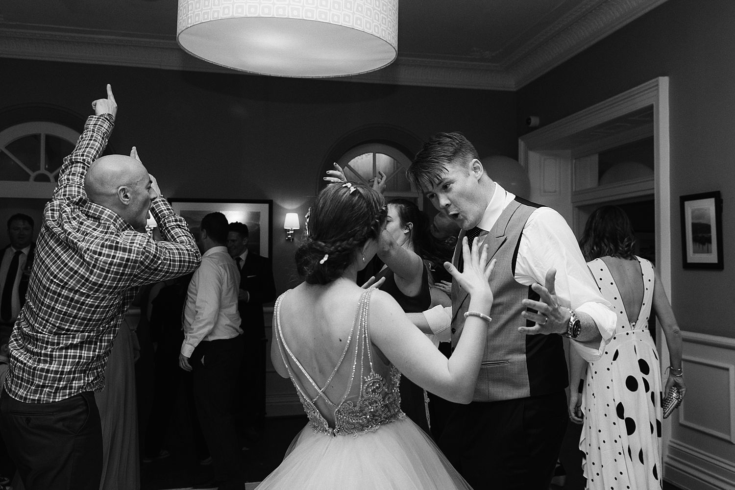 Bride and groom dancing at evening reception at Lake District wedding venue, Belsfield Hotel