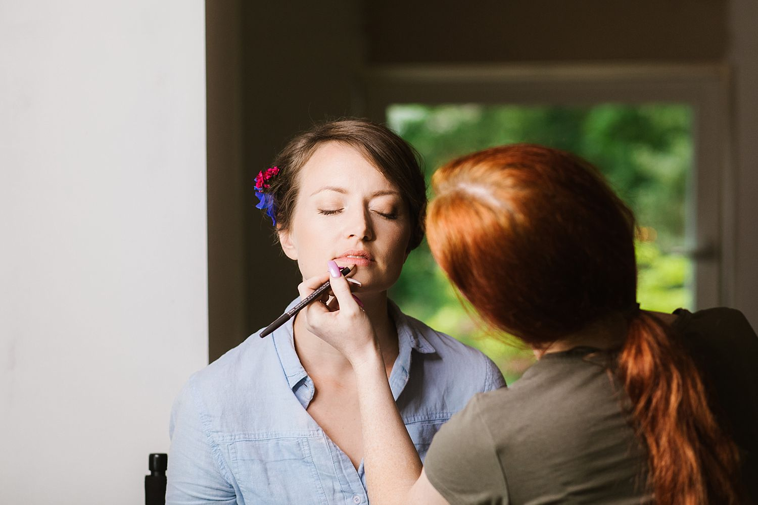 Finishing touches to bride's wedding make up for wedding at Park House Barn, Heversham