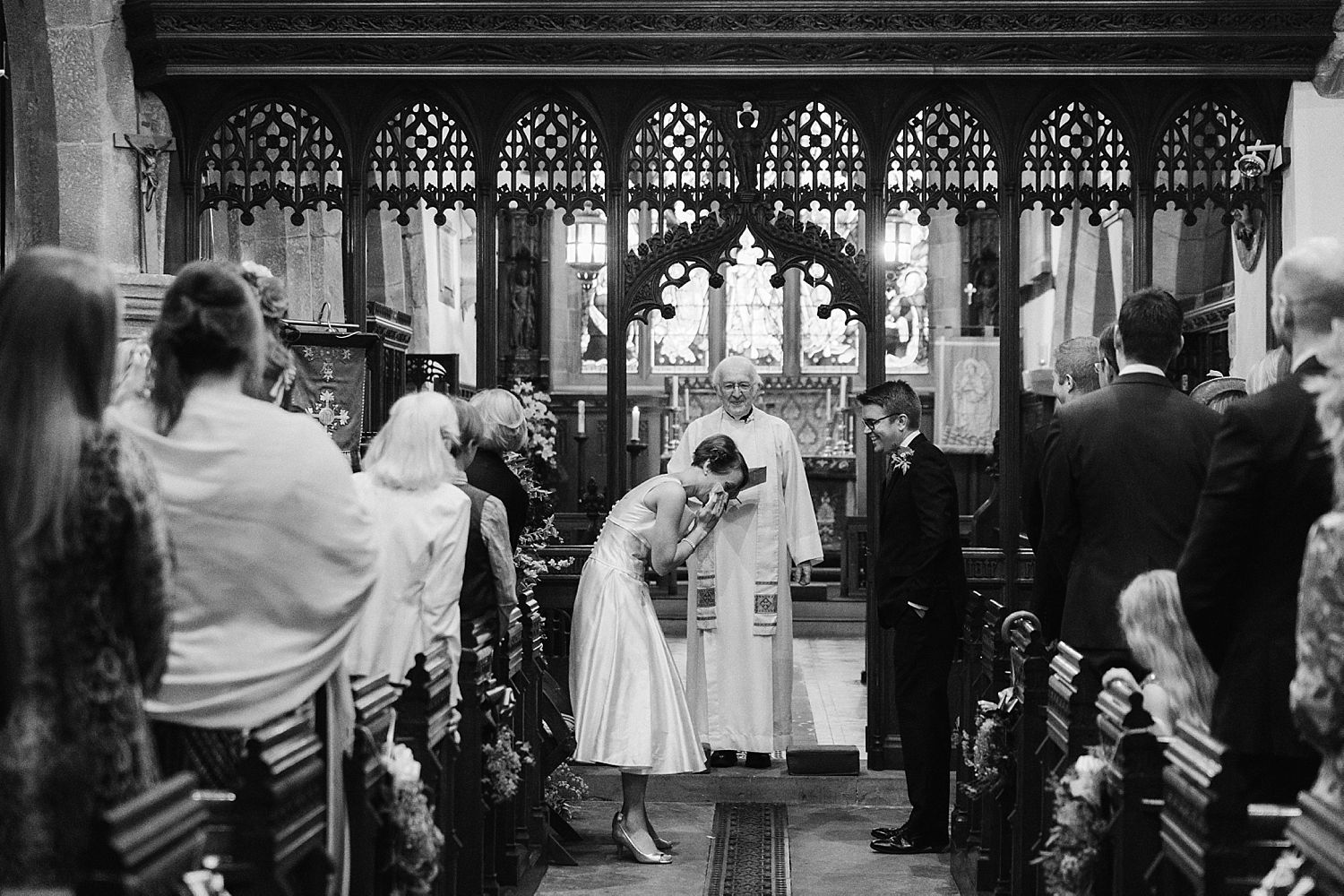 Bride giggling during church ceremony at Park House barn wedding