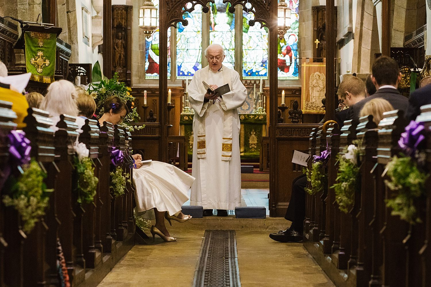 Vicar presides over ceremony in church at Park House Barn wedding