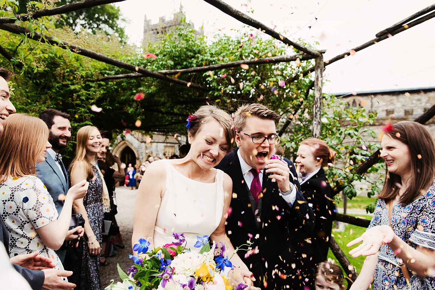 Close up of bride andgroom in confetti shower at Park House Barn wedding