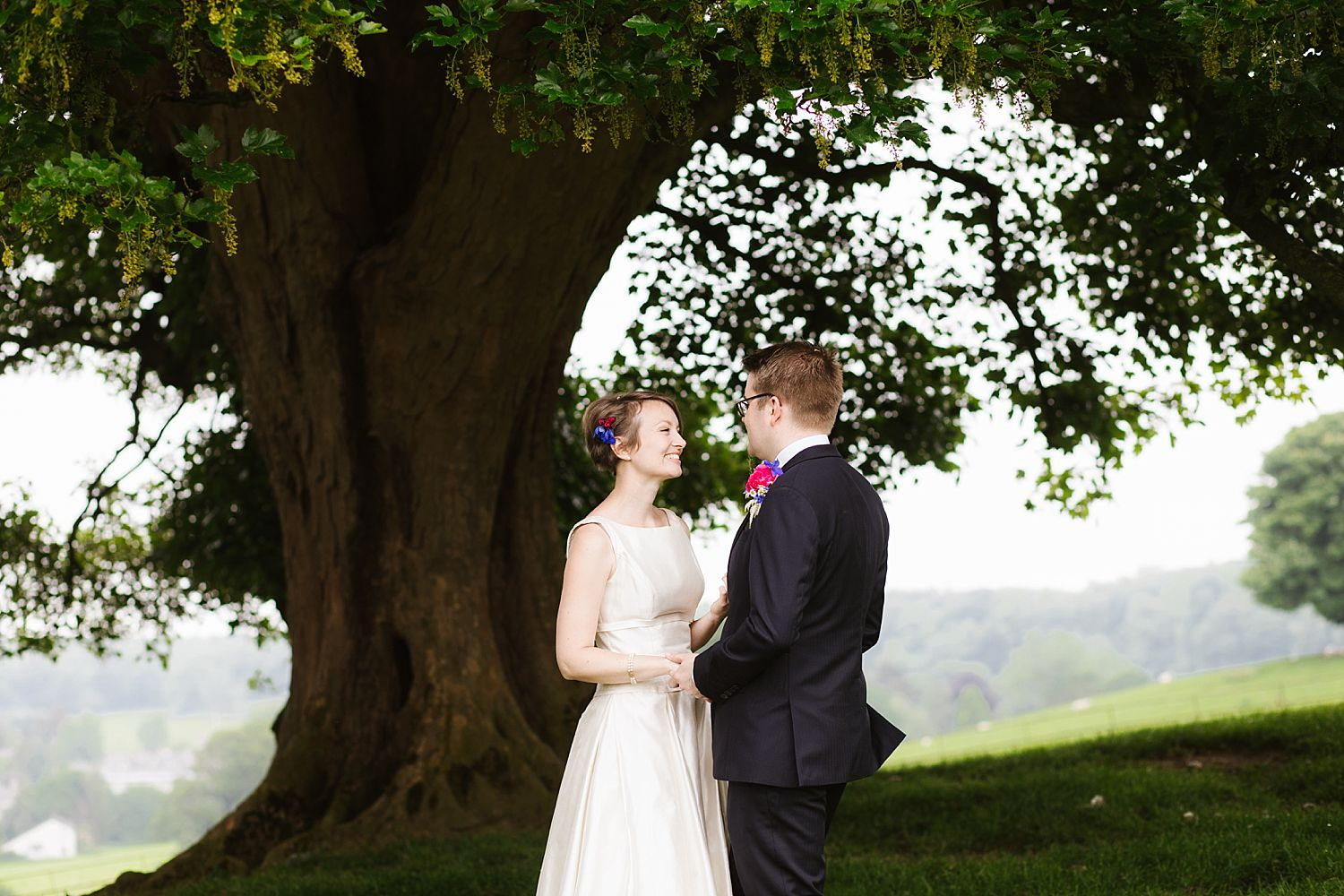 Bride and groom portrait under tree at country wedding venue, Park House Barn