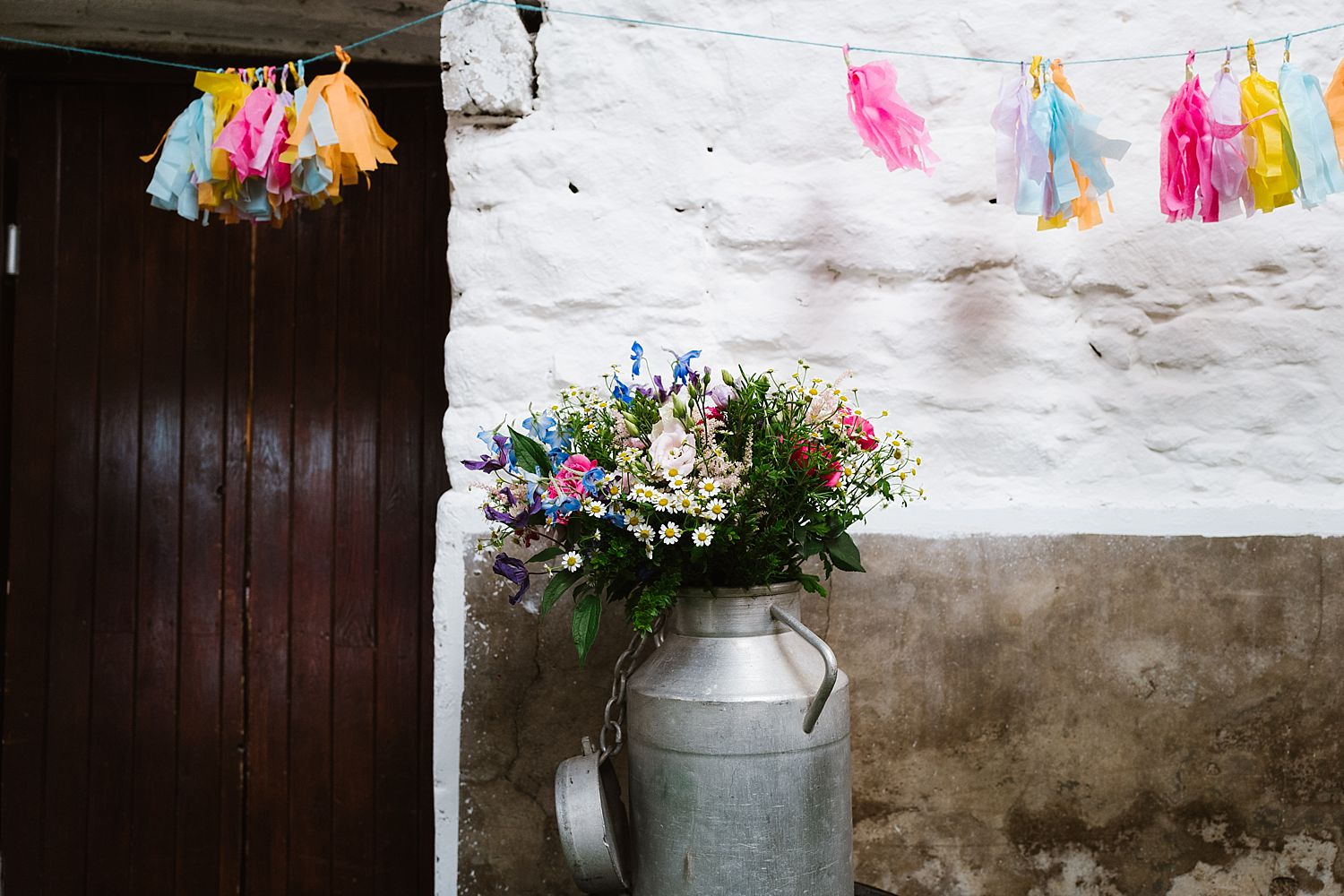 Flowers in milk churn, Floristry by Carmen- and mini pompoms at Park House Barn wedding reception
