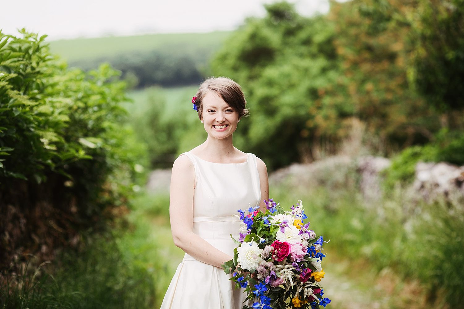 Beautiful bride with spring bouquet by Floristry by Carmen, at Cumbria wedding venue, Park House Barn