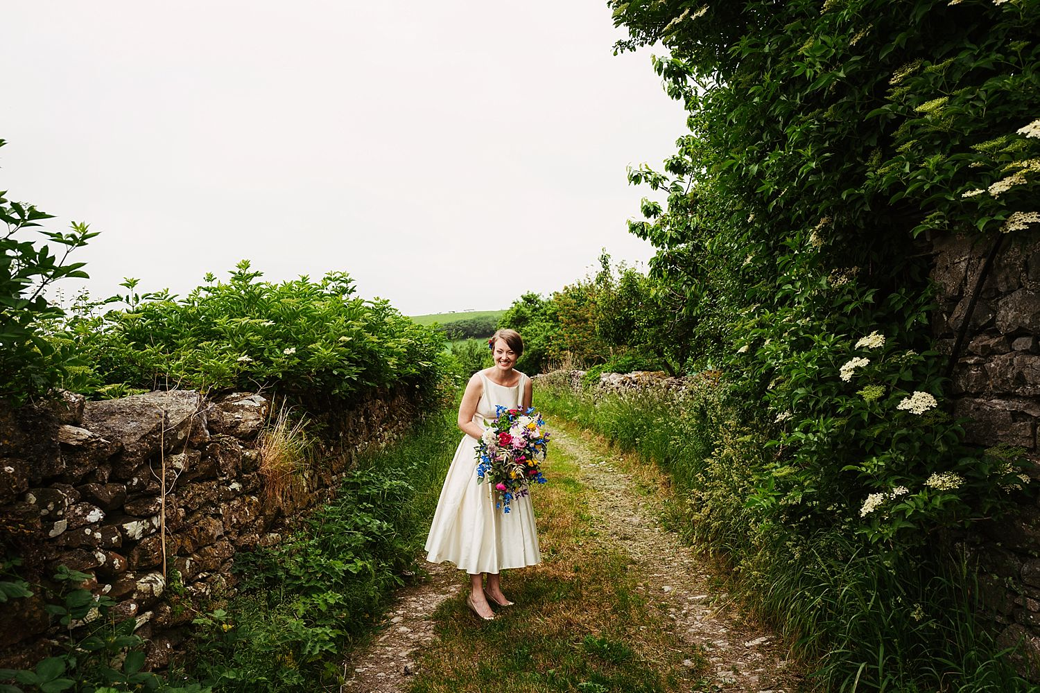 Bride in lane at rural wedding venue, Park House Barn