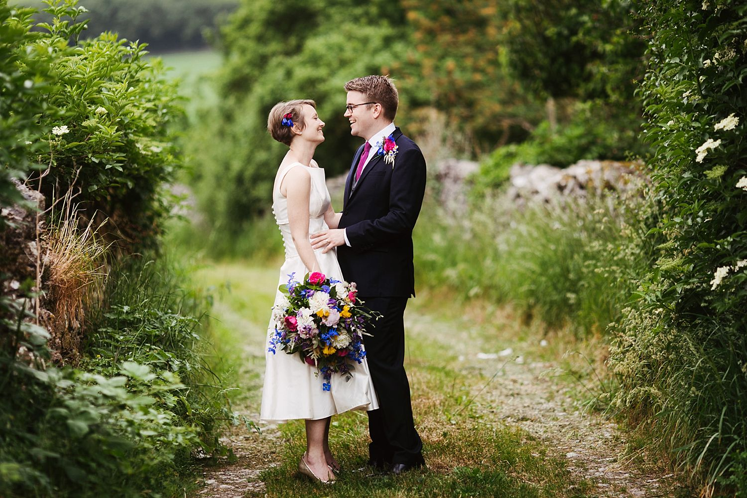 Bride and groom in lane at South Lakeland wedding venue, Park House Barn