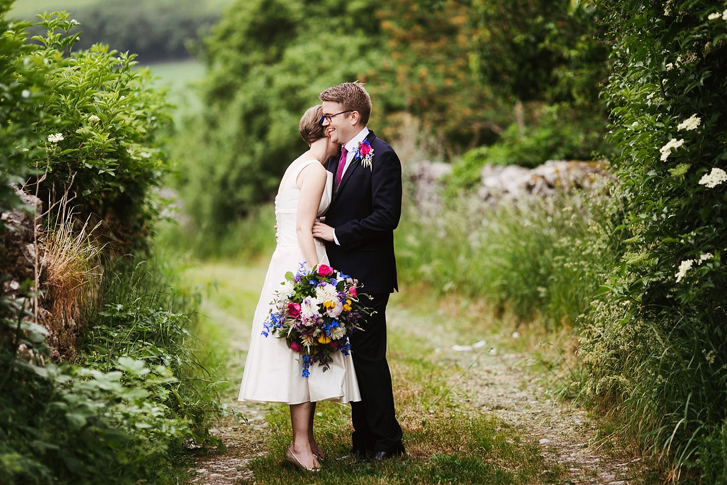 Bride and groom moment together in lane at Lake District wedding venue, Park House barn. Floristry by Carmen