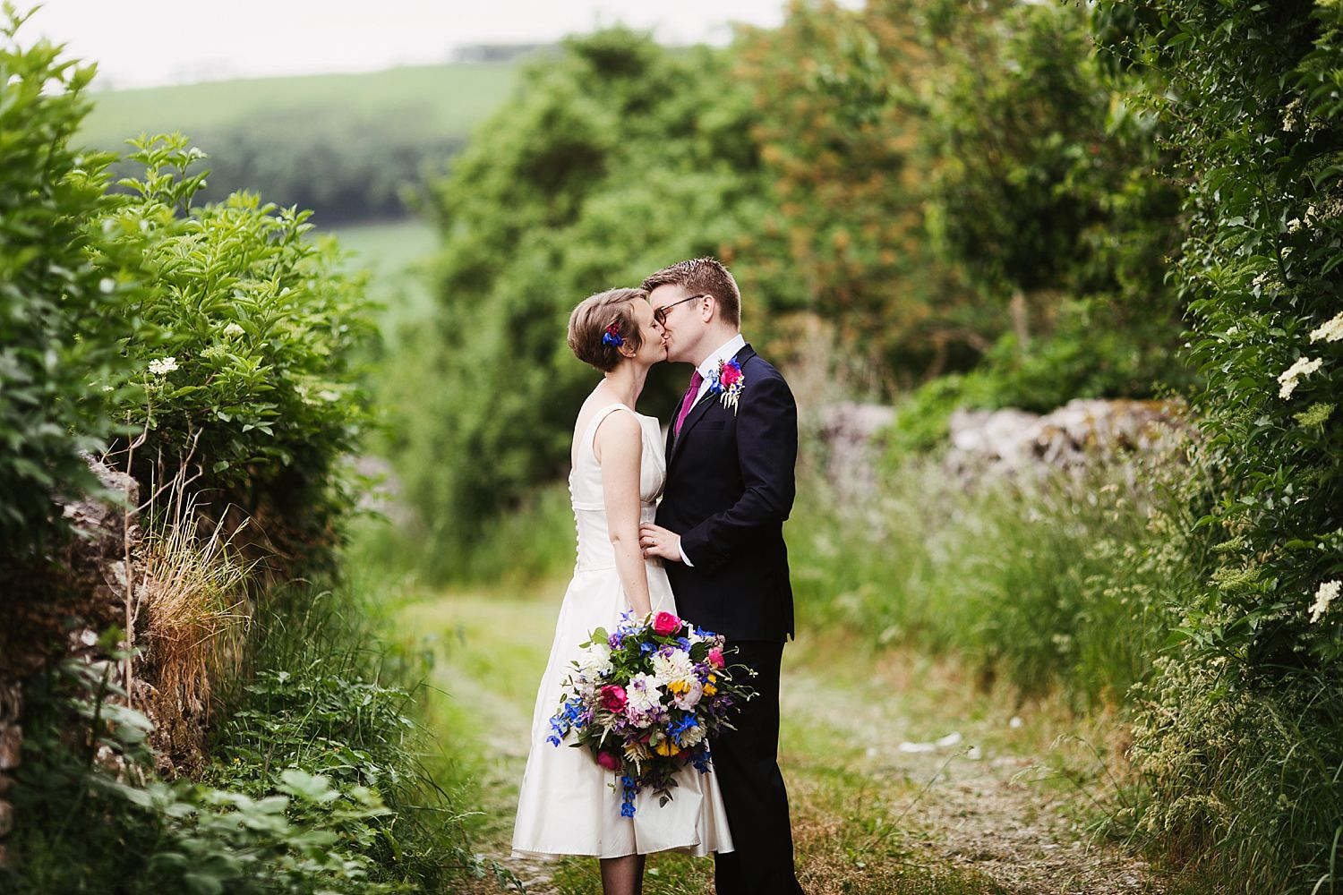 Bride and groom share a kiss at Park House Barn wedding