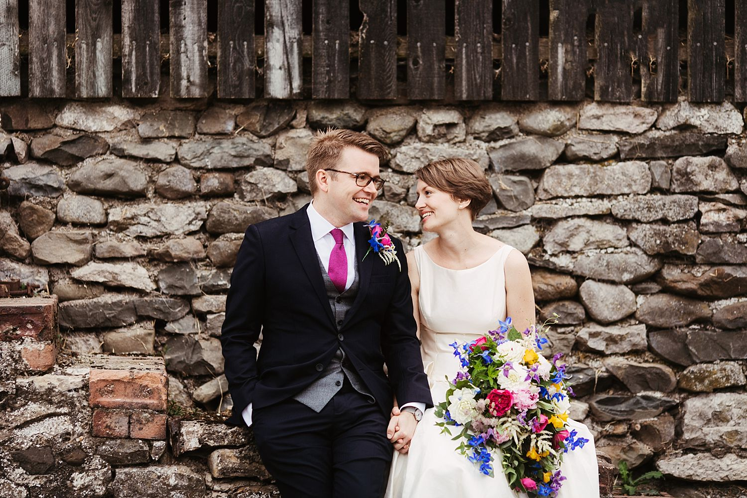 Bride and groom outside Cumbria's Park House barn wedding venue
