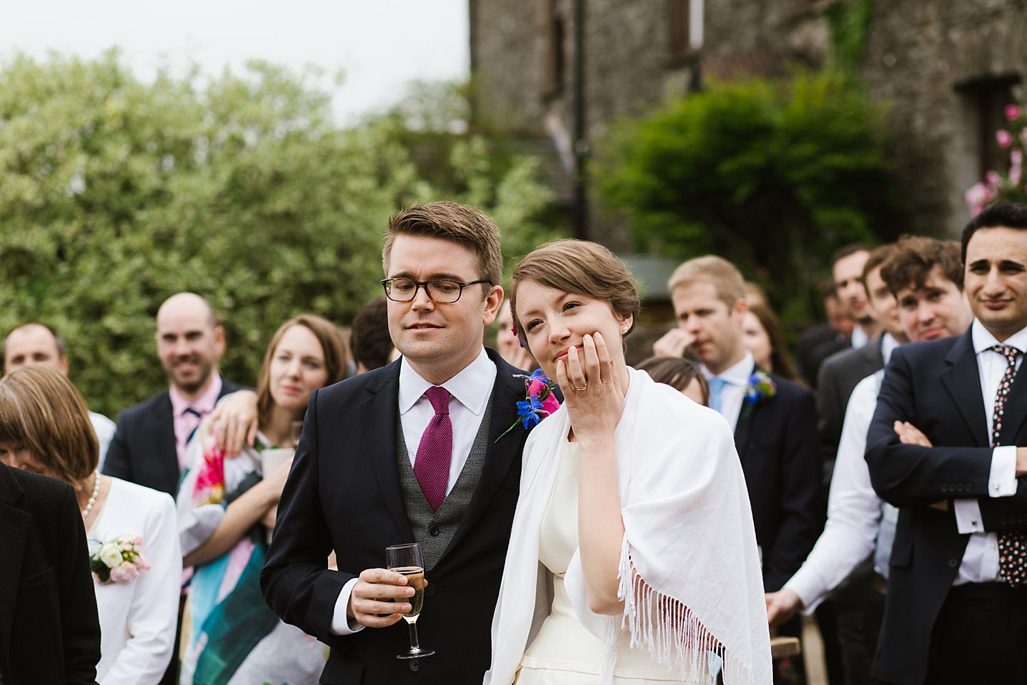 Thoughtful bride and groom with guest at Park House Barn wedding venue, South Lakeland