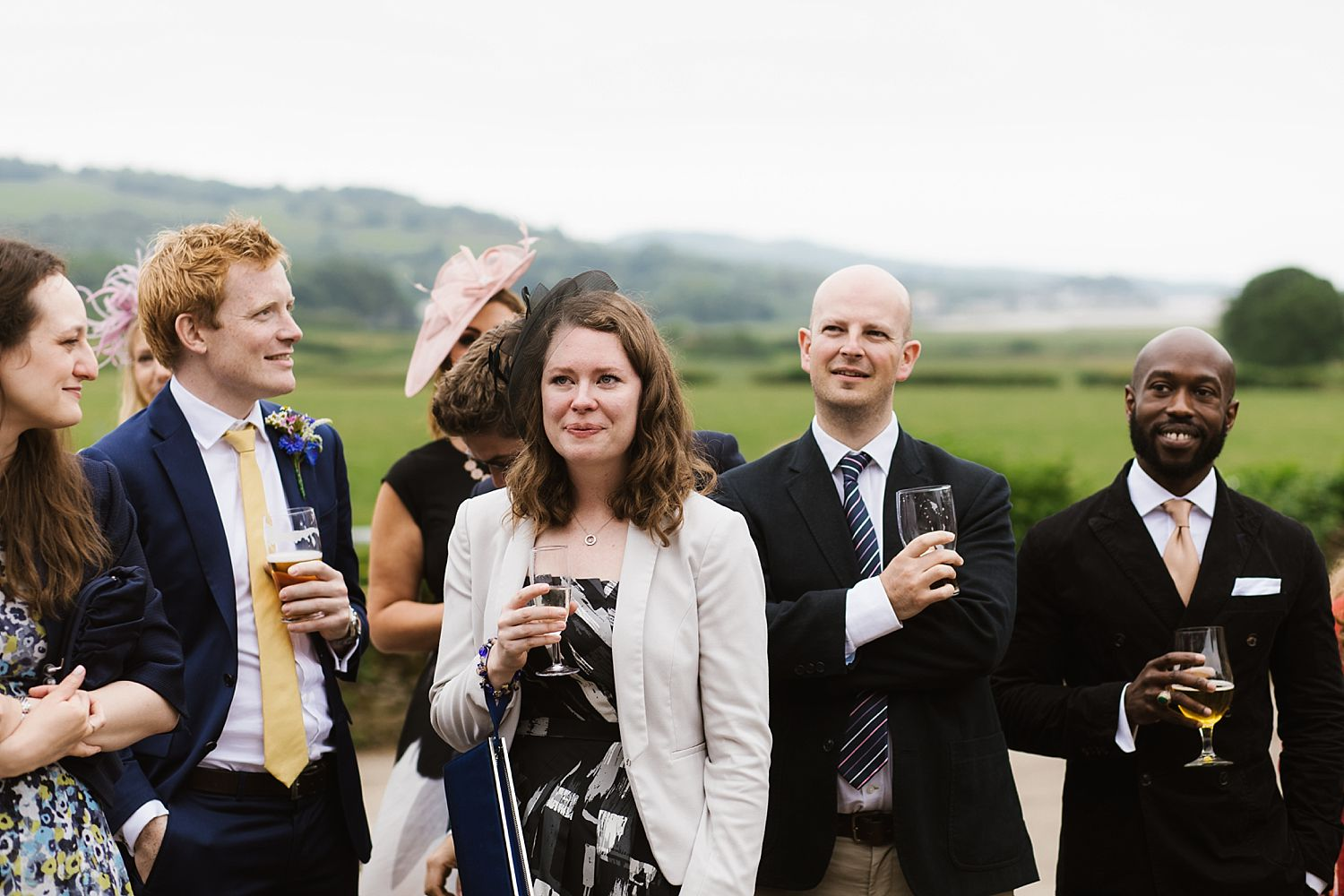 Guests with champagne glasses in hand at South Lakes wedding venue, Park House Barn
