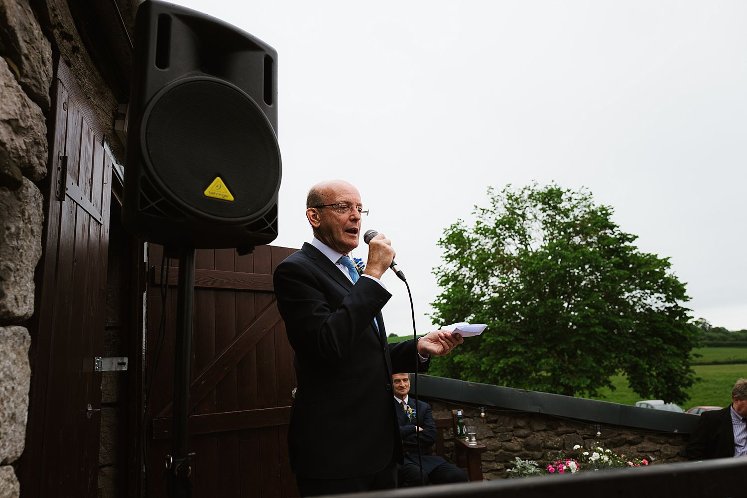 Outdoor speech at Park House Barn wedding reception