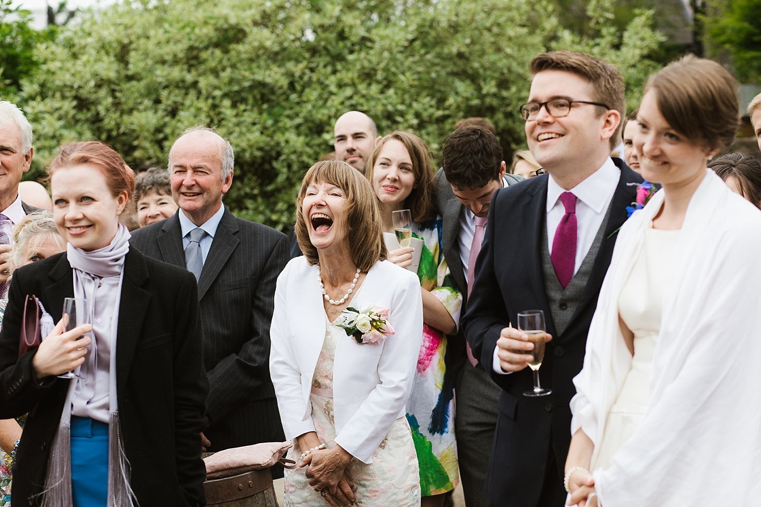 Guests enjoying outdoor speech at Park House Barn wedding reception