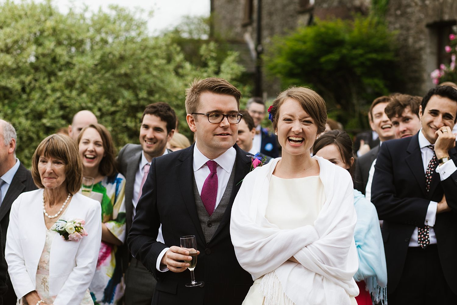 Bride and groom enjoying outdoor speeches at Park House Barn wedding