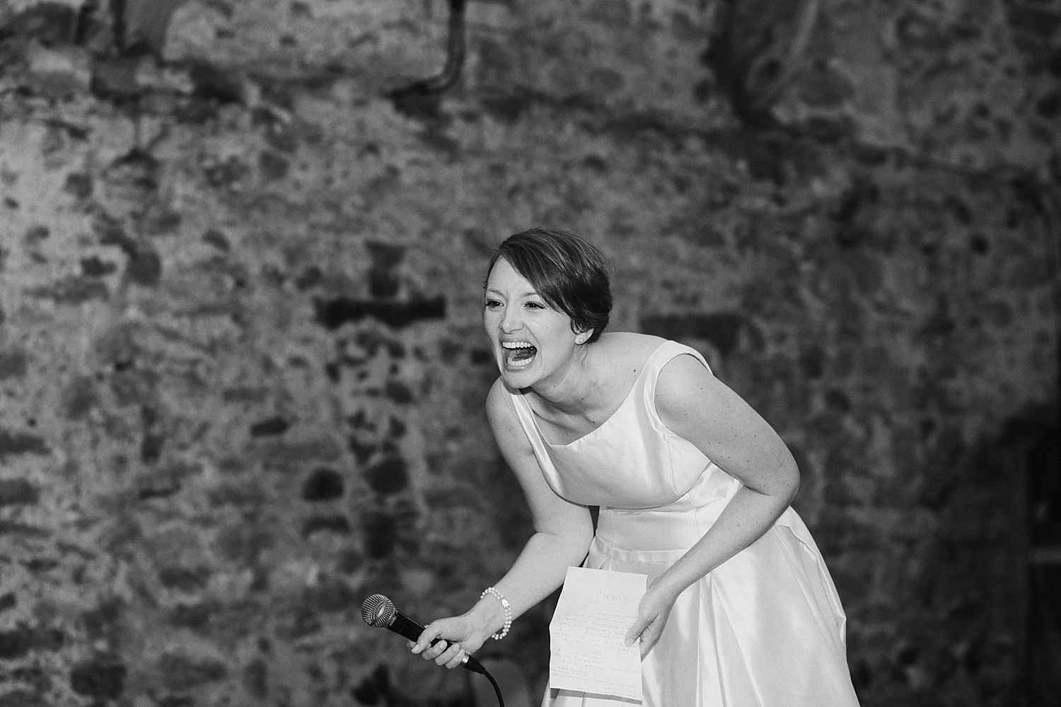 Bride laughing during her speech at Park House Barn wedding