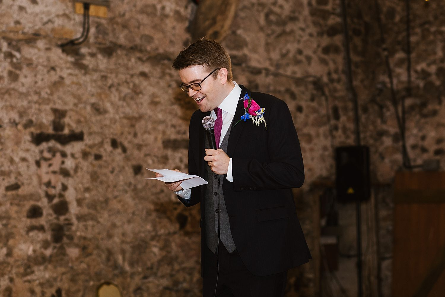 Groom making speech in big barn at Park House Barn wedding venue