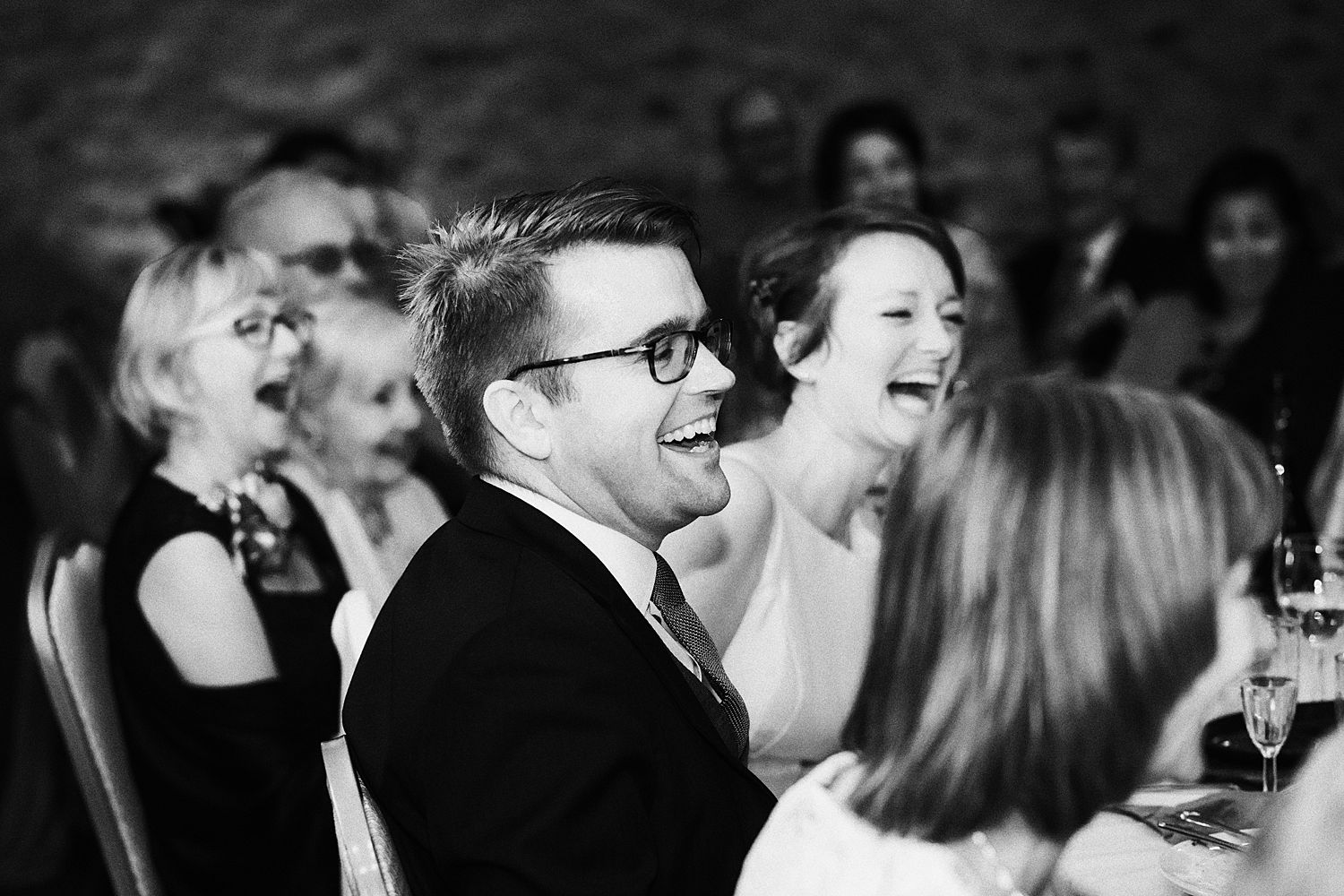 Groom and bride laughing at speech at South Lakeland wedding venue, Park House Barn