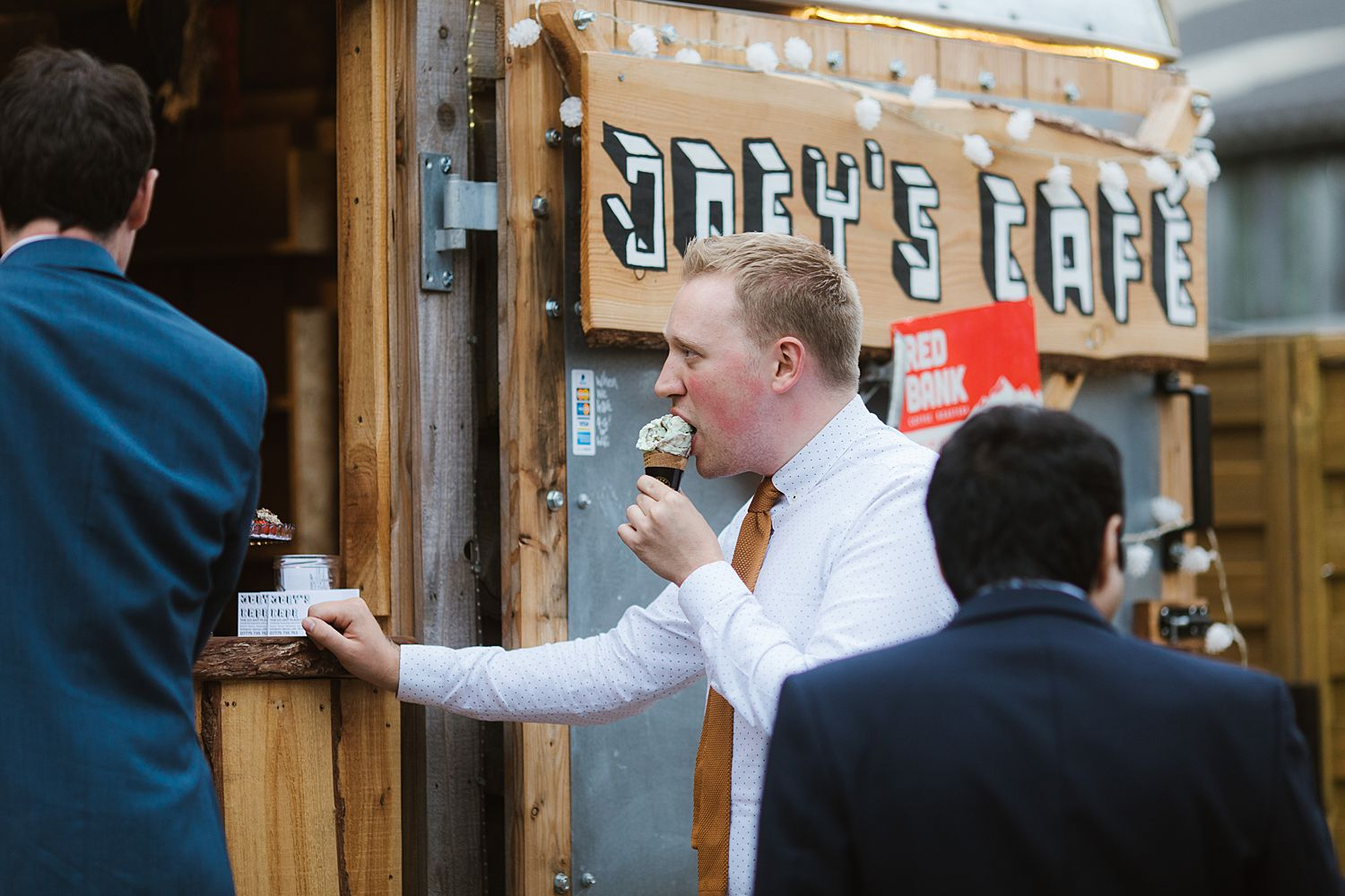Guests eating ice cream at South Lakeland wedding venue, Park House Barn