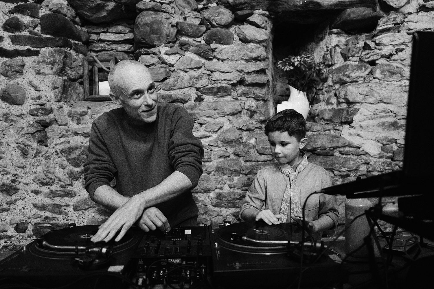 DJ and little boy on the decks at Park House Barn wedding
