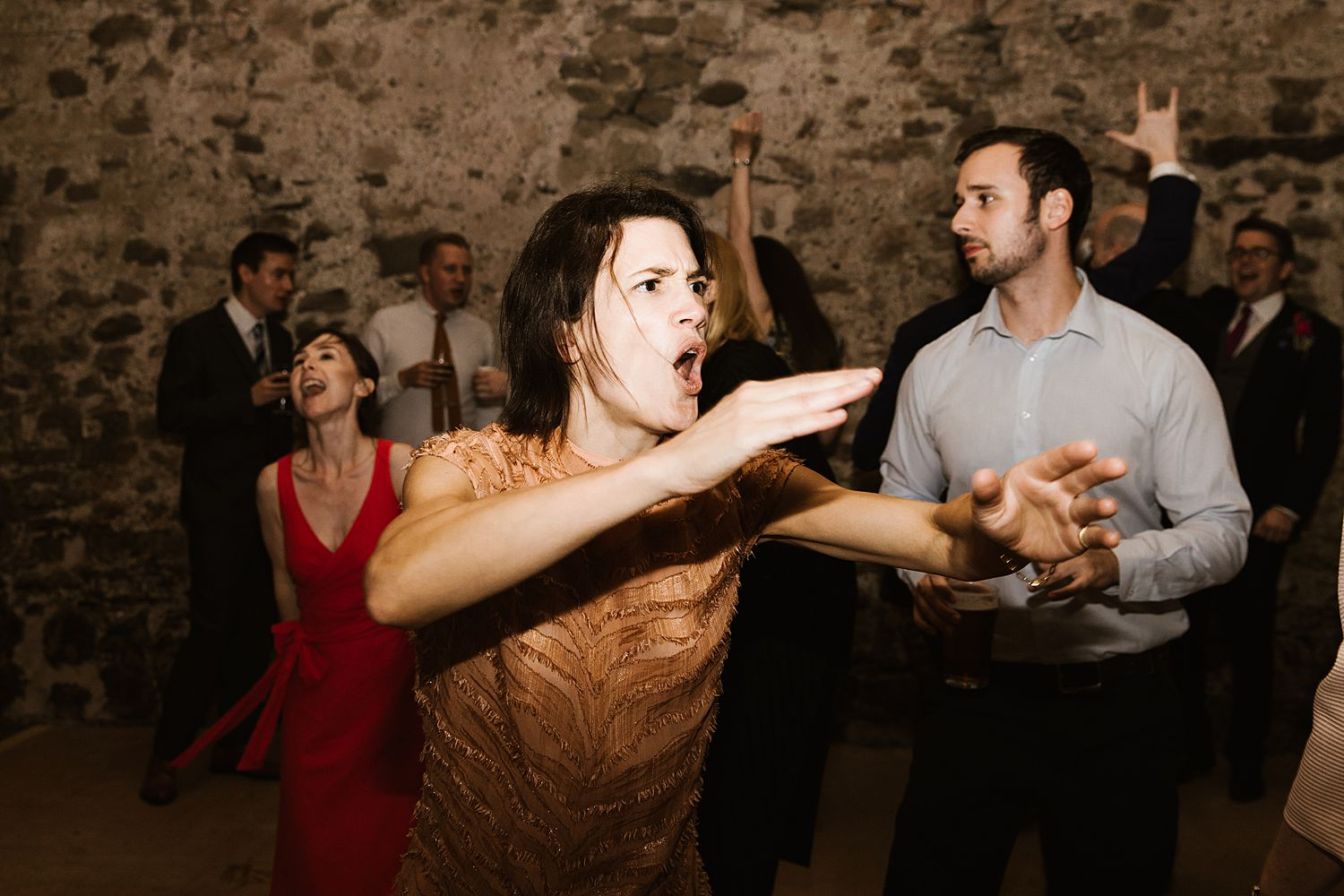 Dancers on the dancefloor at evening reception of Park House Barn wedding venue