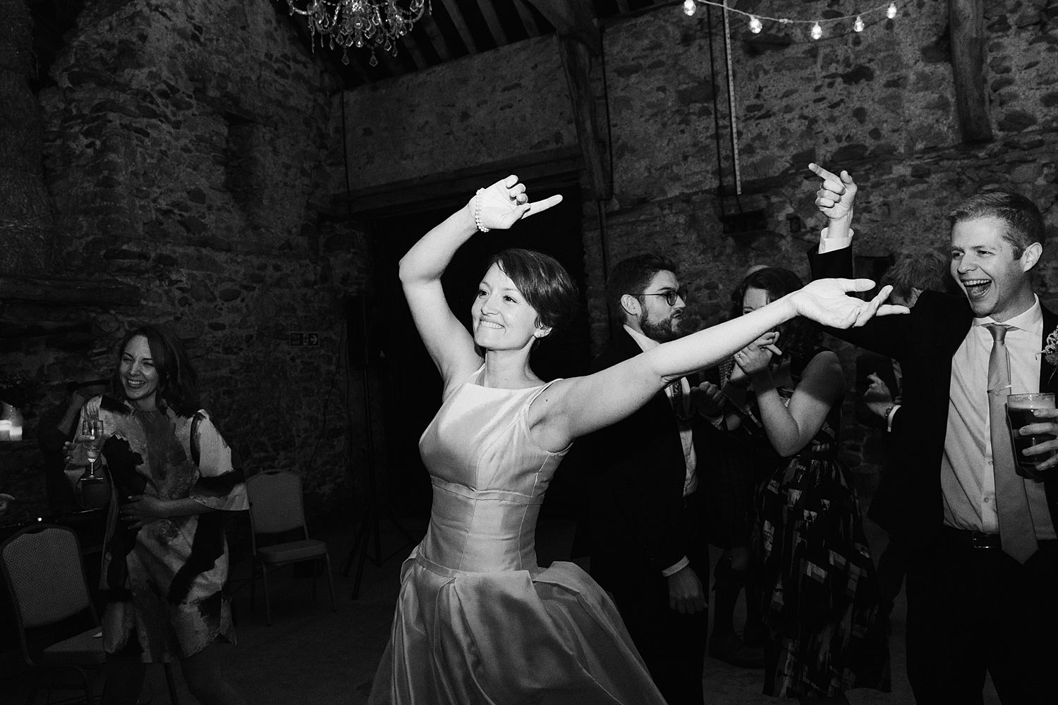 Bride dancing at wedding reception in South Lakes wedding venue, Park House Barn