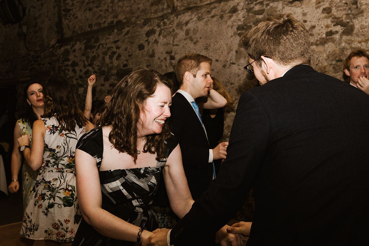 Guests dancing, enjoying evening reception at Sough Lakes wedding venue, Park House Barn