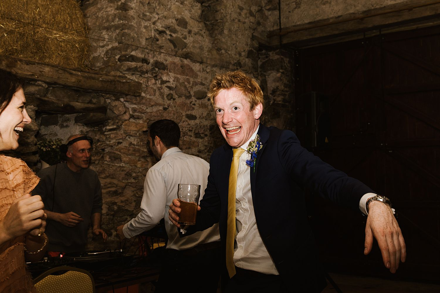 Best man with pint dancing at Cumbria wedding, Park House Barn