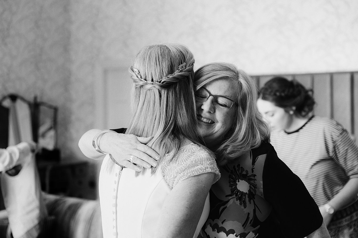 Bride and mum hug at Lake District wedding venue, Storrs Hall