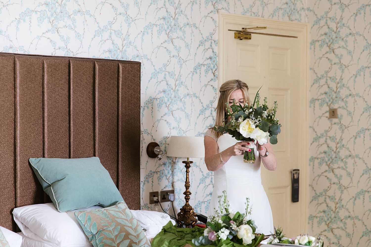 Bride with her bouquet from Brackens florist, Windermere at Storrs Hall wedding