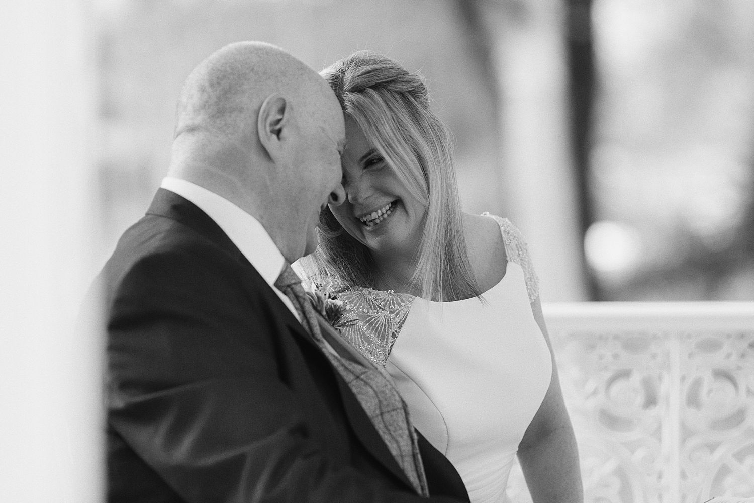 Bride and groom, close up, smiles at Storrs Hall wedding, Lake District wedding venue