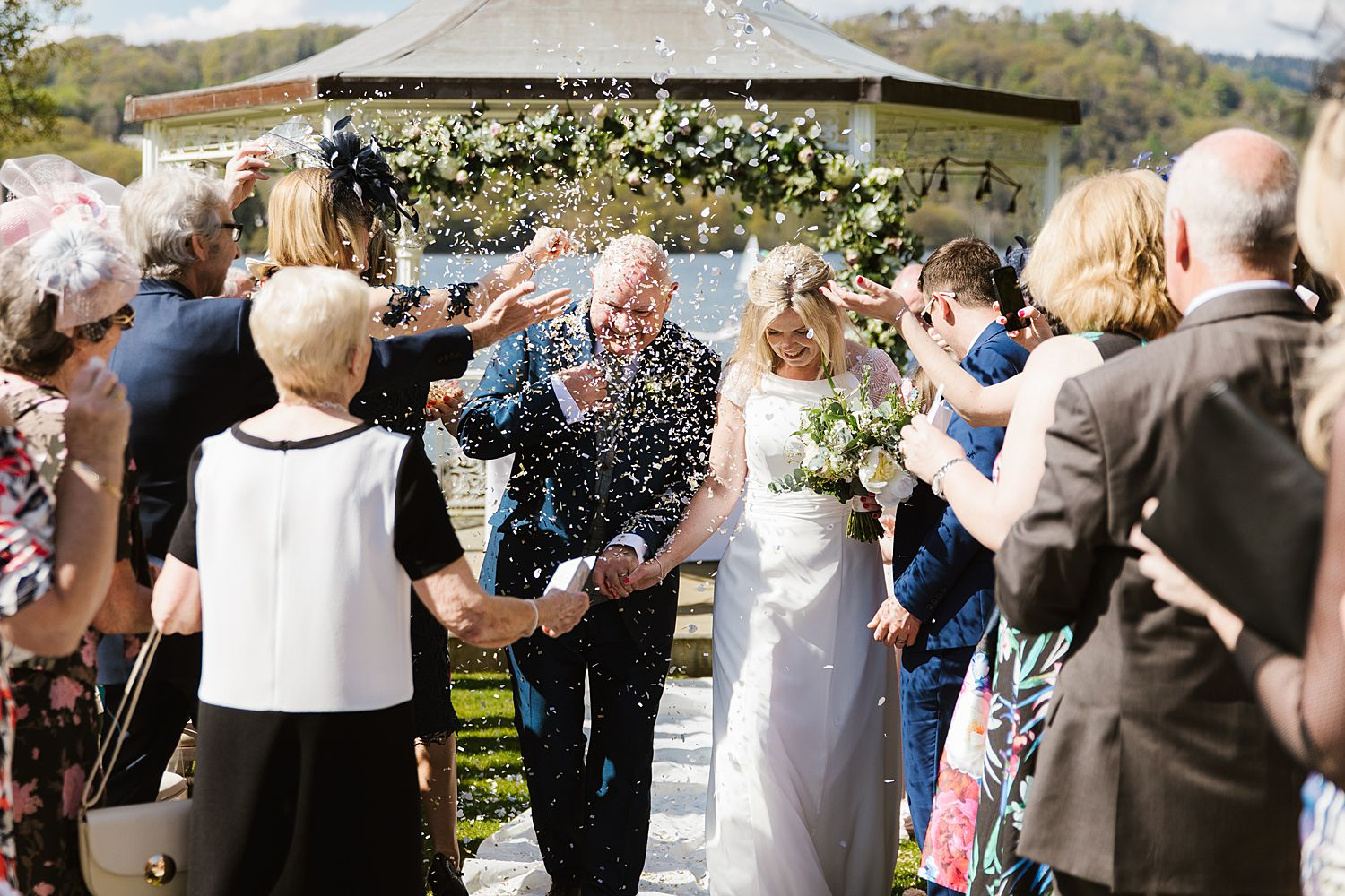 Confetti shower, bride and groom at Storrs Hall wedding, Bowness on Windermere