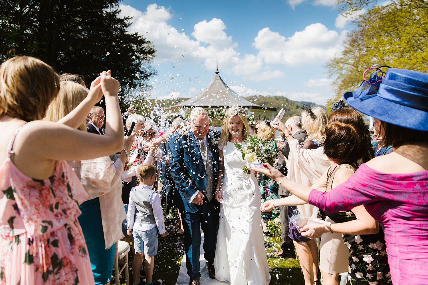 Guests throwing cobfetti at Bowness on Windermere, Storrs Hall wedding