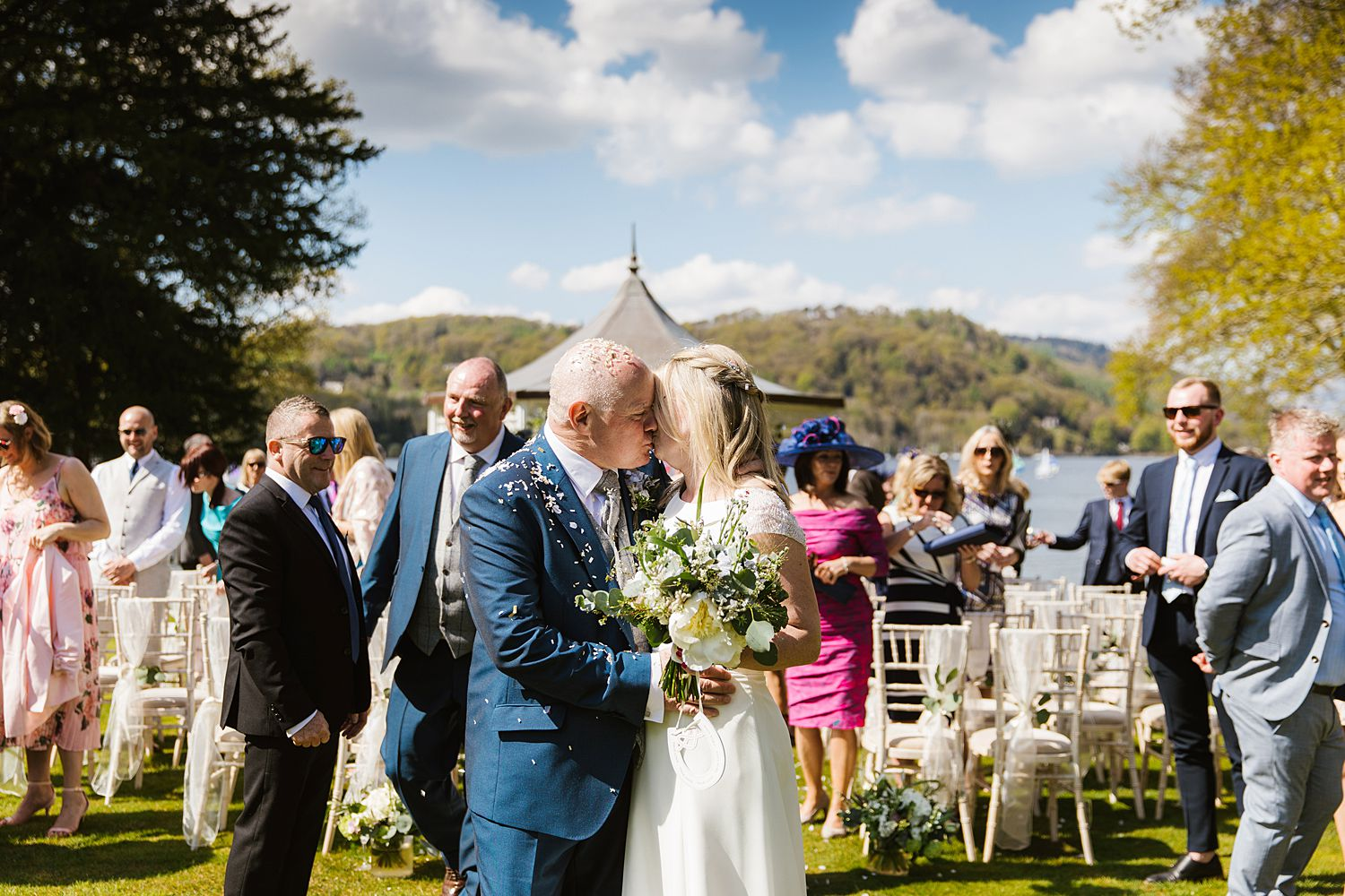 Bride and groom share a kiss at Lake District wedding venue, Storrs Hall