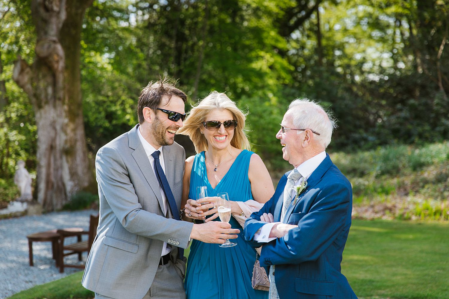 Guests with chanpagne at Storrs Hall wedding, Bowness on Windermere