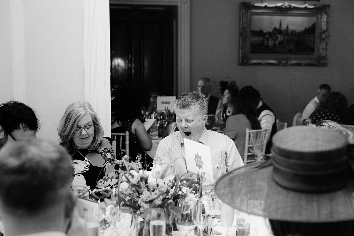 Guests seated at receptionat Storrs Hall, Lake District wedding venue