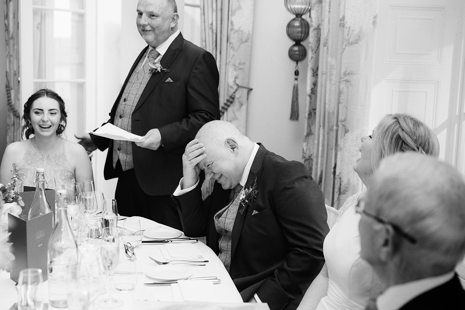 Groom's reaction to best man's speech at Lake District Wedding reception
