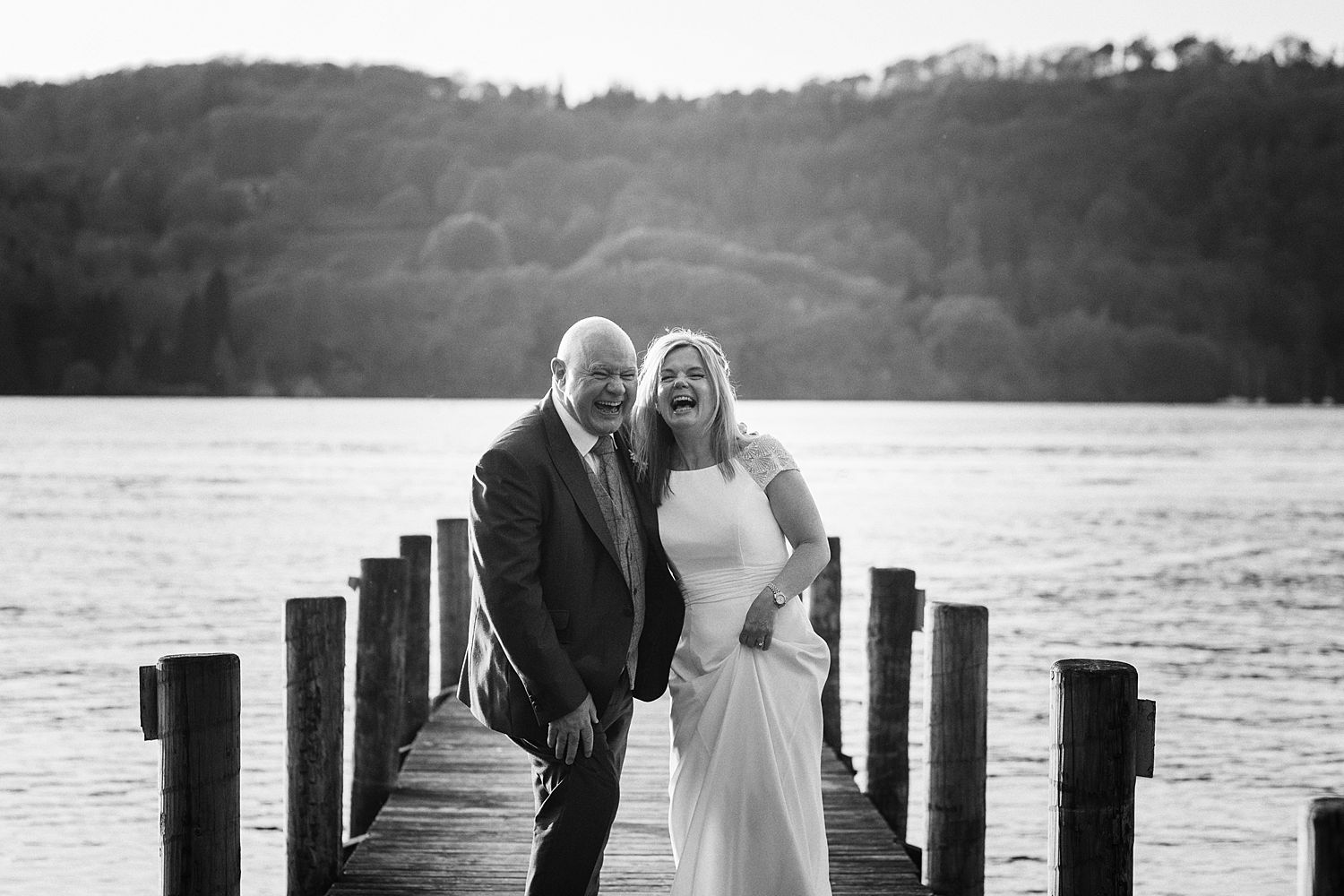 Bride and groom on jetty at Lake Windermere, Storrs Hall Hotel wedding