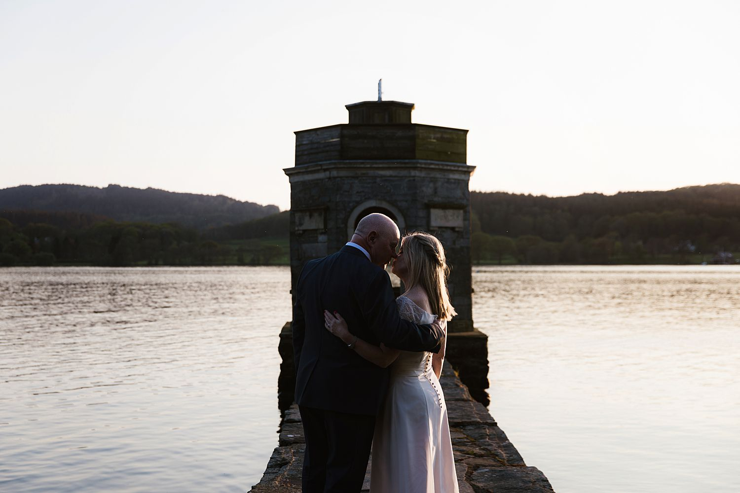 Kissing at the folly at Storrs Hall wedding, Bowness on Windermere