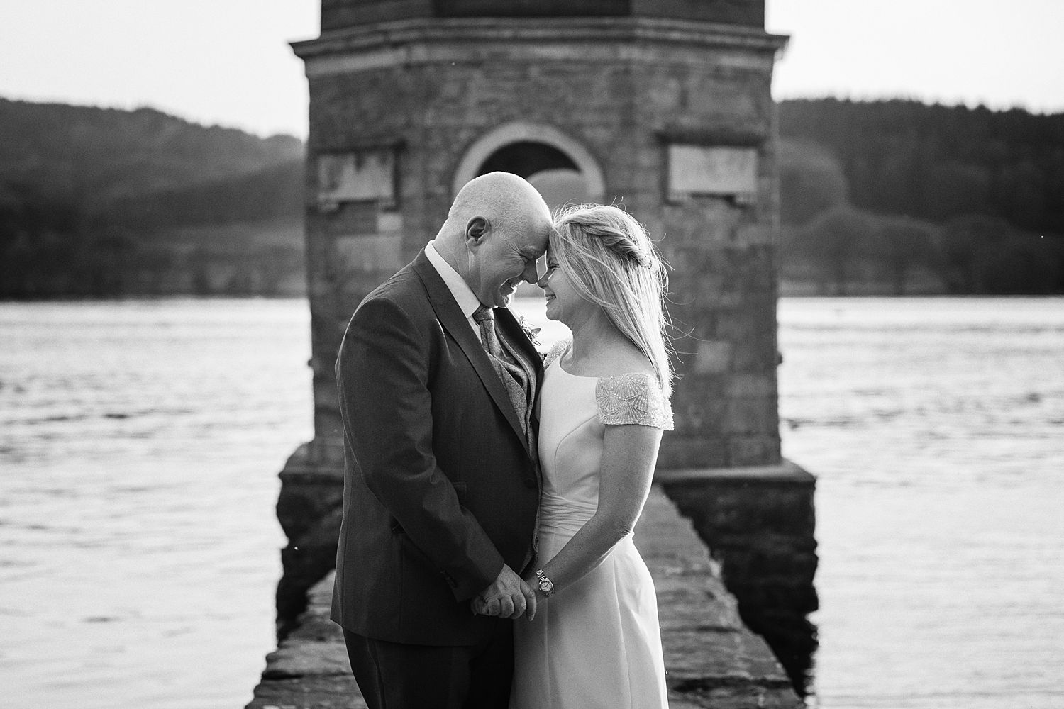 Bride and groom close up, on the jetty at Storrs Hall Hotel, Lake Windermere wedding venue