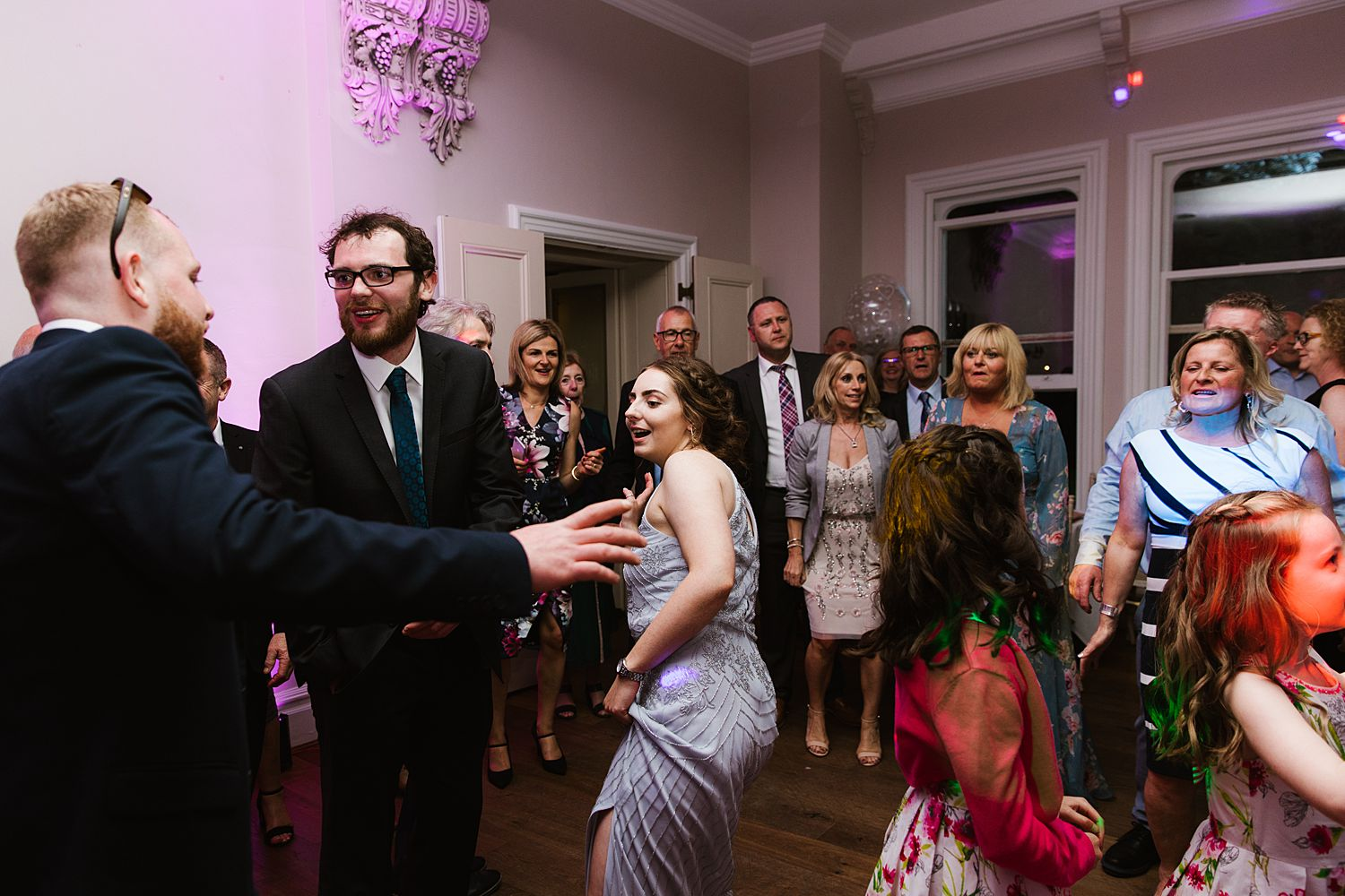 Dancing guests at evening reception at Storrs Hall wedding