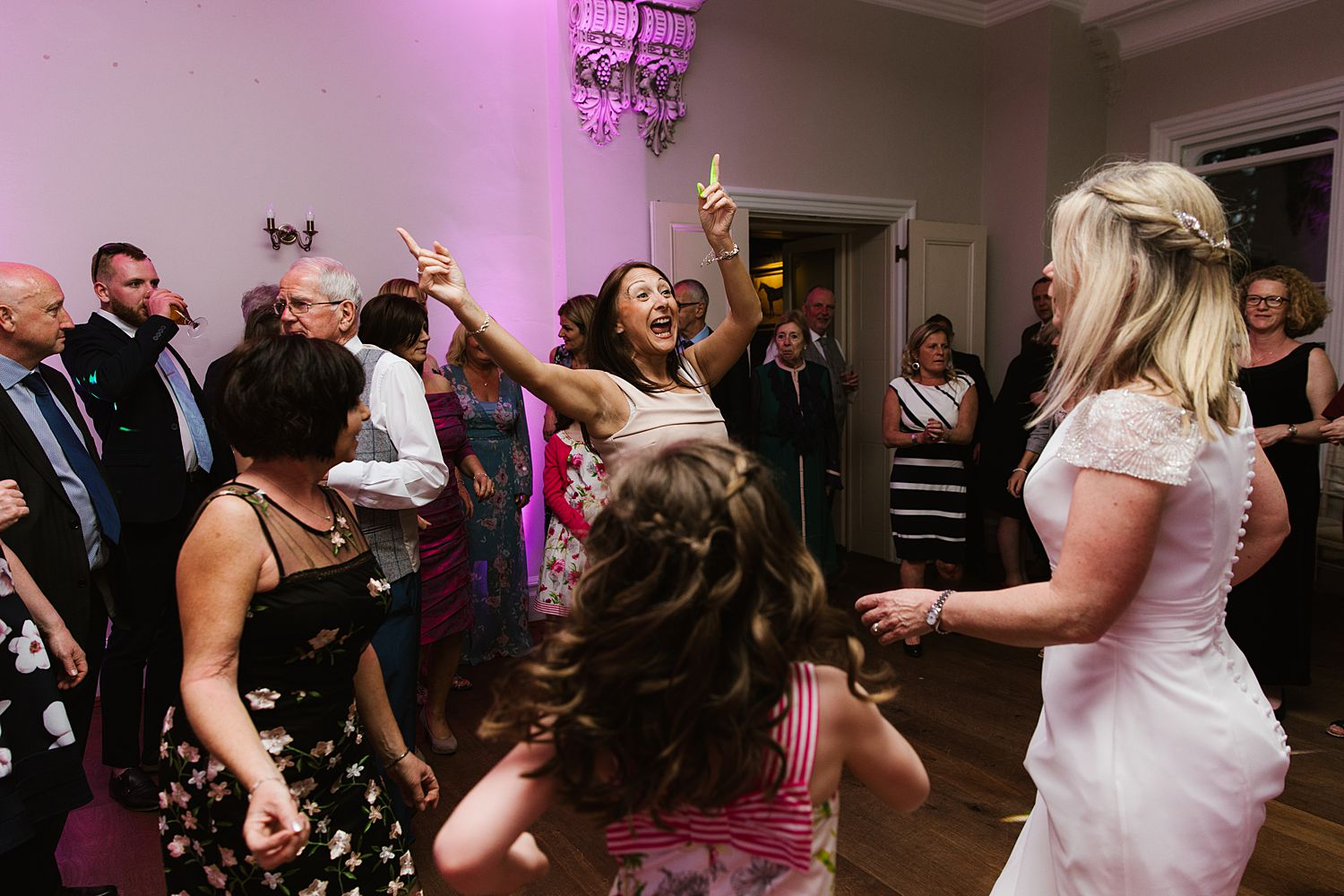 Bride dancing with guests at Lake District wedding venue, Storrs Hall, Hotel