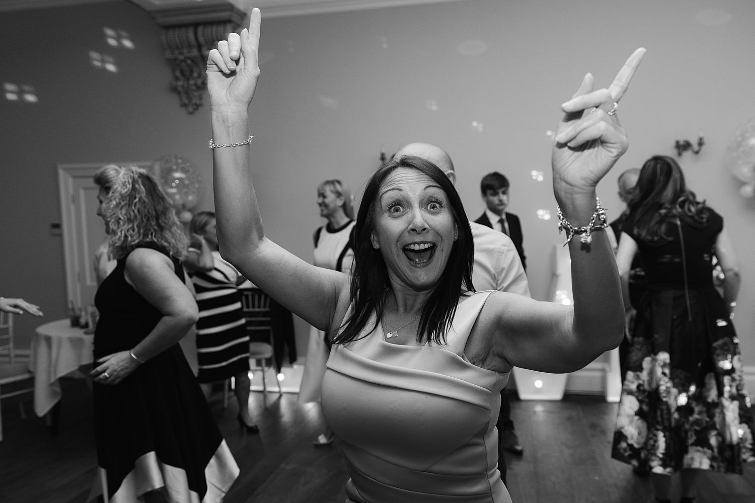 Dancing guest at evening reception at Lake District, Storrs Hall Hotel wedding
