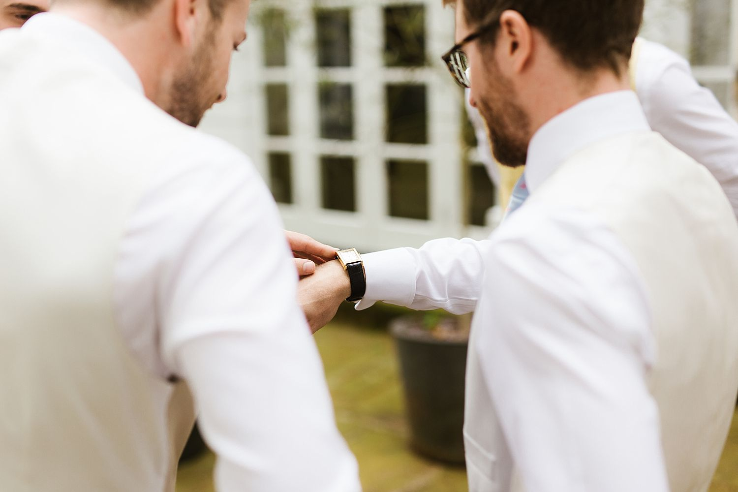 Checking the time before Hampton Court House wedding